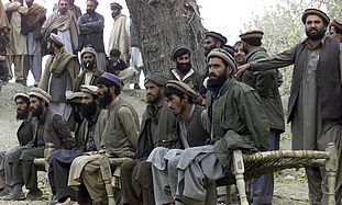 File picture show captured Afghan al Qaeda members sitting on a bench as they are presented to the media in Tora Boraa